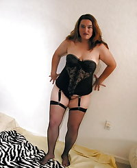 plump older babe in stockings posing and toying