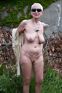 Romy 70yo in the garden of an old house